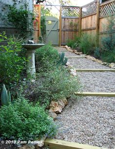 Great plan for side yard. Love fence for more privacy. Simple gravel walkway.