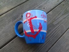 """This holds 2 cups of deliciousness. Started with a small strip of paint to divide the shade of blues. I knew I wanted the anchor and found the a great quote to complement the image. """"This hope we have as an anchor for the soul, is both strong & stead fast.""""  Anchors away!"""