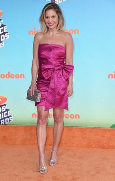 Kids' Choice Awards Fashion 2019: See The Best Dressed Stars – Hollywood Life Kids Choice Award, Choice Awards, Lilly Singh, Yellow Gown, Orange Carpet, Candace Cameron Bure, Seductive Women, Crop Top And Shorts, Poses For Photos