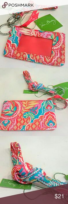 SET lanyard and Zip ID Vera Bradley This color is called Paisley in Paradise and is still sold in stores.  Small wallet zips closed and has clear window for ID and space for bills, coins or chapstick.  Matching lanyard.  Both are new with tags.  I have several other colors listed as well. Vera Bradley Accessories Key & Card Holders