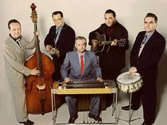 Big Sandy & his fly-rite boys (my handsome husband on steel guitar)