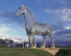 """The Heavy Horse"" by Andy Scott;  ""This sculpture of a Clydesdale Horse has become one of the best known artworks in Scotland.  Sited beside the M8 motorway between Glasgow and Edinburgh, it stands 4.5 metres tall at the head and is made of galvanised steel round bars."""
