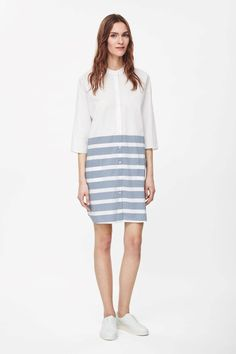 Designed for relaxed everyday wear, this tunic-style shirt dress is made from soft brushed cotton with a contrast striped pattern. A loose, oversized fit, it has dropped shoulder seams, 7/8 sleeves and a button fastening that runs along the front.