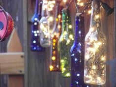 repurposed beer bottles with christmas lights for our garden area