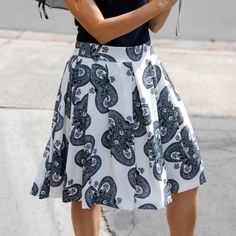 Black & white flowing swing skirt Beautiful swing skirt, perfect for the office or a date this summer! Hidden size zipper, fully lined. Looks awesome with a solid black top and heels 😍 Please refer to size chart. Relished Skirts