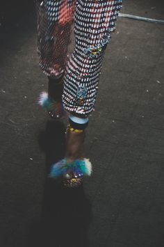 Sequin gingham trousers and feathered shoes backstage at Ashish SS15 LFW. More images here: http://www.dazeddigital.com/fashion/article/21749/1/ashish-ss15