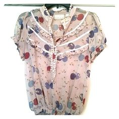 KIMICHI & BLUE- Cute flowery Blouse It is super cute with jeans and shorts. It has a cute pattern but it gives me a vintage vibe due to the front details.  It also has elastic scrunchy detail that gives it volume. It has been worn once. Feel free to send me offers and ask me questions Kimchi Blue Tops Button Down Shirts