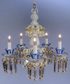 Teacups chandelier in blue and gold...pinned by Annacabella