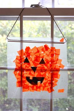 Kid friendly craft: Tissue Paper Pumpkins {Tutorial} Tissues is super fun as a sun catcher and display, so many uses this fall and very colorful for kids to work with