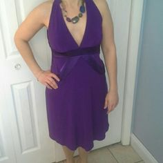 Cocktail dress Purple dress. V-cut front and scoop back. Fits tighter below the bust, and looser around the hips. Built in bra. 95% polyester and 5% spandex. Not lined underneath.  Worn once.  Will fit a size 4-6. NW Collections Dresses