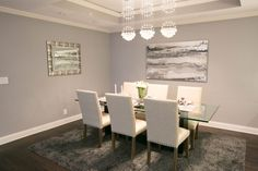 Has a dining room ever looked so delicious than this space with its deep gray rug, DIY art, and table perfect for hosting?