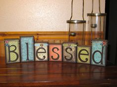 Boutique Wooden Block Set. This set includes (7) blocks which spell out BLESSED. The tallest block measures 6 tall & 3.5 wide. The shortest