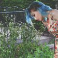 Aimee_NG_blue_hair_smelling_floweres