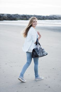 young girl on the beach, leather bag, fur, sturdy details. Doctor Deer