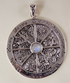 This detailed necklace depicts symbols and Zodiac signs corresponding with each Sabbat. The pagan Wheel of the Year is an annual cycle of eight seasonal festivals consisting of solstices and equinoxes