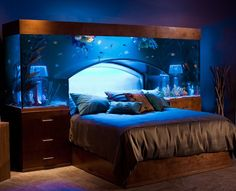 Aquarium Headboard by Acrylic Tank Manufacturers. Even has bedside lamps built into the tank.  This is amazing!!!