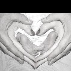 Mom & Dad's hands with baby's feet in a heart