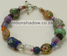 Hand-crafted Bracelet with cat-face detail. Price: (R95 - that's approximately $9.70/€7.30) http://moonshadow.co.za/online_shop/bracelets/bracelet-sku-fbr010.html  This cheerful bracelet comprises mainly glass, porcelain and Indian finely decorated metal beads. Features cat-face detail. Hand-crafted in South Africa.