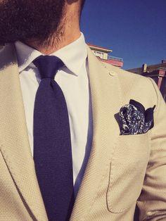 Beige blazer and navy tie