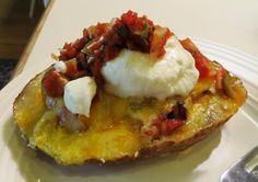 Breakfast Potato Skins 4 large russet potatoes 5 large eggs 1 tablespoon water 1 -2 tablespoon butter (do not substitute margarine) 3 tablespoons vegetable oil 1/2 teaspoon sea salt (or regular table salt) 1/4 teaspoon garlic powder 1/4 teaspoon paprika 1/8 teaspoon pepper 6 -8 slices bacon, cooked and crumbled 2 cups shredded cheddar cheese 6 -8 green onions, sliced 2 cups sour cream