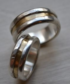 LOVE IT, but too expensive. his and hers wedding bands - artisan designed handmade fine silver and 14k yellow gold wedding bands - matching rings - customized. $1,500.00, via Etsy.