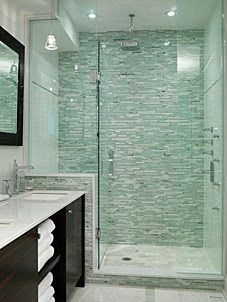 This is gorgeous! A great example of using mosaic tile on one wall in shower and then keeping the other walls neutral. I also love how they put the mosaic on the exterior of the shower curb and half wall.