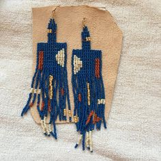 """salihah moore europa earrings hand beaded earrings from colorado artist salihah moore. inspired by abstract art and beaded in vibrant colors. approx 4.5"""" in length handmade in colorado gold fill earwire"""