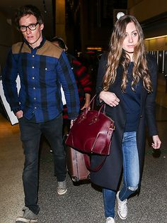 Star Tracks: Tuesday, January 12, 2016 | AWAY WE GO | Meanwhile, parents-to-be Eddie and Hannah Redmayne wear coordinating travel outfits as they head out of LAX on Monday.