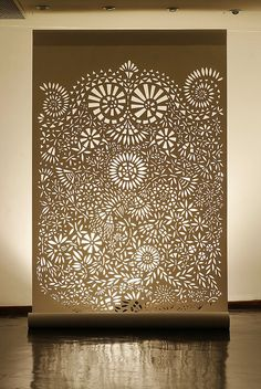 What an incredible display piece this would make. Boxed wood frame, mount rope lighting to inside of frame, design cut from thin plastic sheet and backed with white silk. Large or small designs would both create impressive effects.
