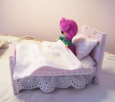 Side view of new mini lala doll beds