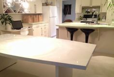aubrey annie: old table ($3.99 thrifted table taken to an auto body shop | now virtually indestructible) | beautiful white kitchen!