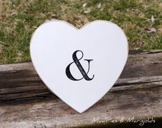 """Want a fun and unique photo prop for wedding pictures and announcments OR a cute decorative piece at the reception!    Create """"mr & mrs"""" or """"bride & groom"""" images!    This wooden heart will be painted in YOUR choice of paint colors and then lightly distressed around the edges.  T...    $16.95"""