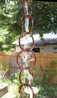 Copper tubing made into a rain   chain for the front of the house