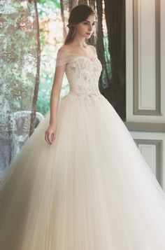 This dreamy off-the-shoulder gown from Sonyunhui featuring illusion sleeves and…