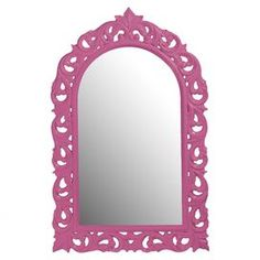 """Finished in chic pink, this eye-catching wall mirror showcases a scrollwork frame with fleur-de-lis accents.    Product: Wall mirrorConstruction Material: Resin and mirrored glassColor: Hot pinkFeatures:  Glossy finishArched rectangular frameCarved, ornate scroll design Dimensions: 47"""" H x 30"""" WCleaning and Care: Wipe with a soft cloth"""