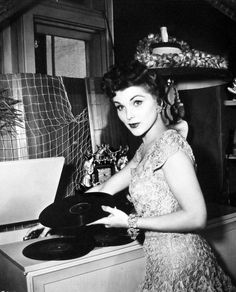 """vintagegal: """" Debra Paget playing records at home c. Classic Hollywood, Old Hollywood, Hollywood Music, Lps, Vinyl Junkies, Cinema, Record Players, Vintage Vinyl Records, Celebs"""