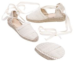 PAZ espadrilles from www.espadrillesetc.com  A naturally romantic sole born with an aura of serenity, PAZ's ruffles are just for fun.