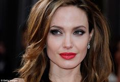 The natural look: Women with natural, full lips like Angelina Jolie are drawn to motherhood and frequently put the needs of others before their own