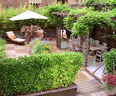 This deck proves that you can still have a cozy, comfortable, and private outdoor living space in the city. The deck sits atop a New York City condo building and squeezes lots of living space into a small area. The rooftop retreat is divided into multiple outdoor rooms including an outdoor kitchen, separate dining area, and a secluded nook for lounging.