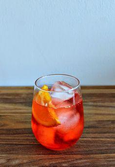 campari spritz cocktail recipe: campari, prosecco, club soda via Mint Love Social Club