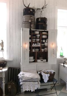 Great use of an old painted armoire to store white dishes, love the hat boxes and antlers. Vintage Interior, Interior, Home Decor Items, Home, House Interior, Home Deco, White Rooms, Interior Design, Decorating Your Home