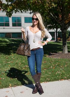 A classic Fall outfit.  Ivory sweater with dark skinnies and brown riding boots.