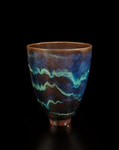 GERTRUD AND OTTO NATZLER Footed vase, 1962 Earthenware, blue, turquoise and copper glaze with iridescence, crystal formations and flow patterns. cm) high Underside signed with NATZLER and with original inventory label printed Raku Pottery, Thrown Pottery, Pottery Mugs, Pottery Ideas, Painted Vases, Pottery Techniques, Modern Artists, Glass Ceramic, Contemporary Ceramics