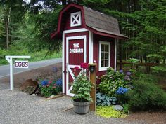 """This is beyond perfect! Keri in Westport, MA sells her eggs from this charming """"egg barn"""" - honor system. Inside there is a small fridge and a place to leave your money, etc. Even the landscaping is picture perfect!!"""