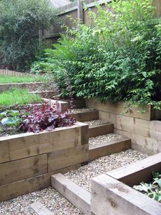 A steeply sloping garden on several levels, with a feature arch, raised beds and shade-tolerant planting. Sloped Backyard Landscaping, Terraced Landscaping, Landscaping On A Hill, Sloped Yard, Landscaping Ideas, Garden On A Hill, Terrace Garden, Terrace Ideas, Raised Patio