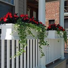 Flower boxes on porch railing