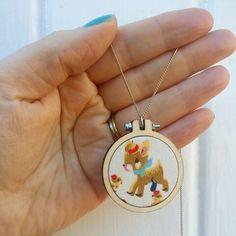 Mini embroidery hoop necklace. Handmade by Emy & Wilma.