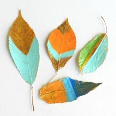 Use acrylic paint and modge podge to make colorful fall leaf decor for your home.