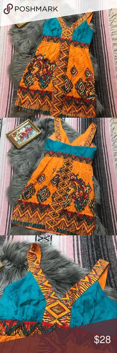 """Phoebe Couture 100% silk dress in a tribal print 6 This 100% silk dress from Phoebe Couture is an eye catcher! Flowing silk material in a fit and flare style creates movement and structure. Wide shoulder straps and v-neckline flatter every body type. Spot on trending spring colors, thick stitch bottom hem detail, & back zipper with hook & eye closure complete this one of a kind dress.  SPECS  Bust 16 1/2"""" Waist (narrowest) 14 1/4"""" Hip (widest) 19 1/4"""" Length (shoulder to hem) 33 1/4"""" Phoebe…"""