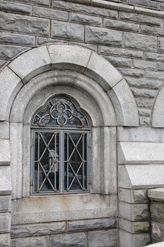 Very cool leaded glass window on stone castle - Central Park, NY